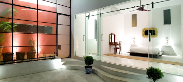 Eclectic style balcony, veranda & terrace by Taller Estilo Arquitectura Eclectic