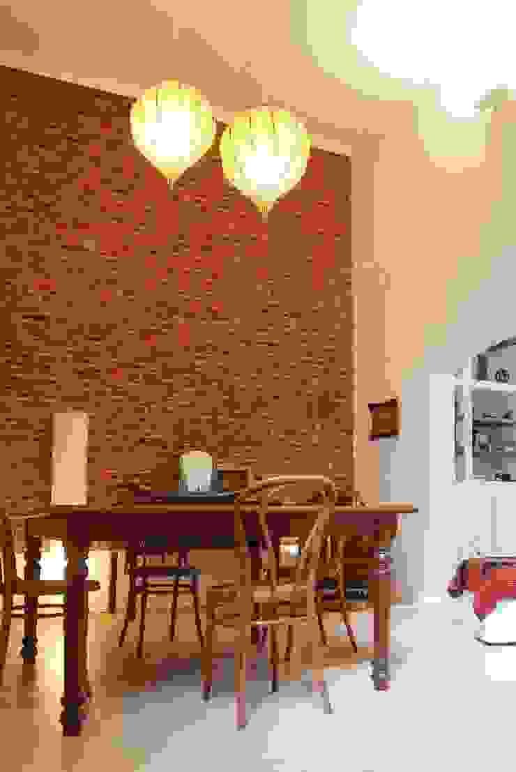 Столовая комната в эклектичном стиле от Parrado Arquitectura Эклектичный