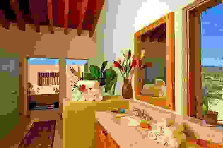 Casa Cariza Balcones y terrazas tropicales de BR ARQUITECTOS Tropical