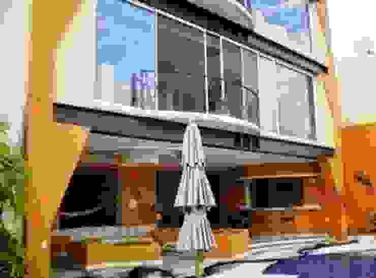 Vista terraza abierta Casas tropicales de ARQUELIGE Tropical