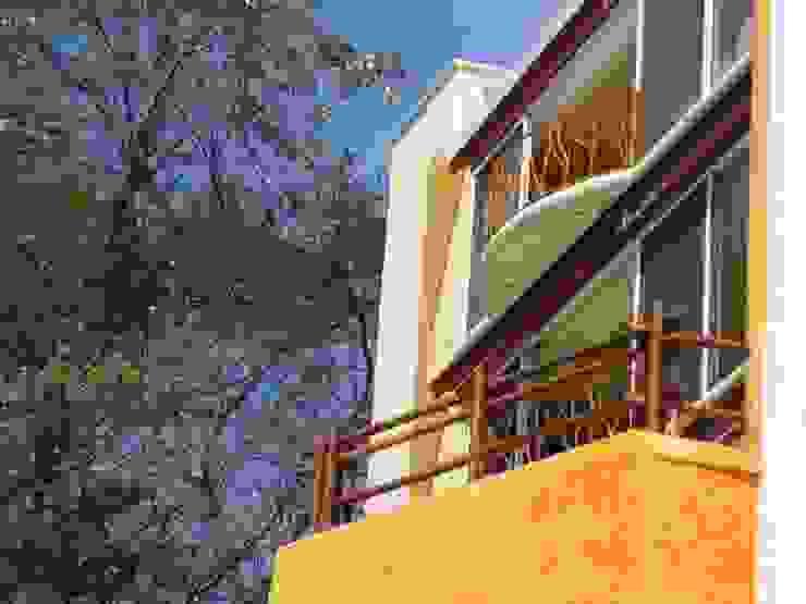 Vista de la Fachada Casas tropicales de ARQUELIGE Tropical