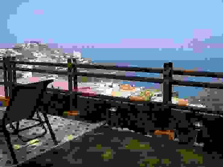 Jardin exterior Balcones y terrazas tropicales de ARQUELIGE Tropical