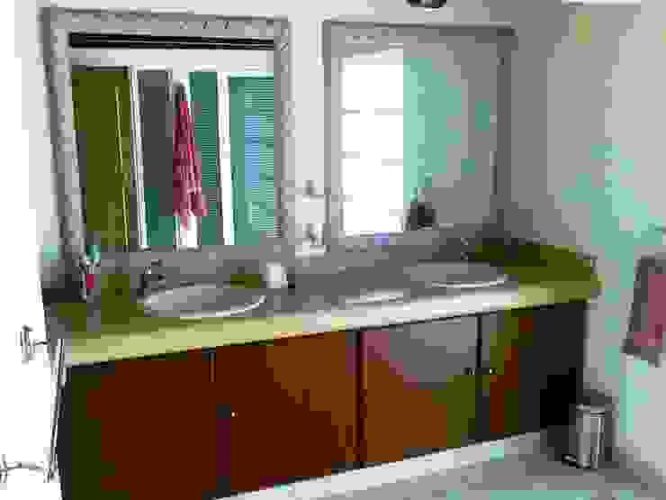 Sala de baño de la Suite principal después de la remodelación de ARQUELIGE Rústico