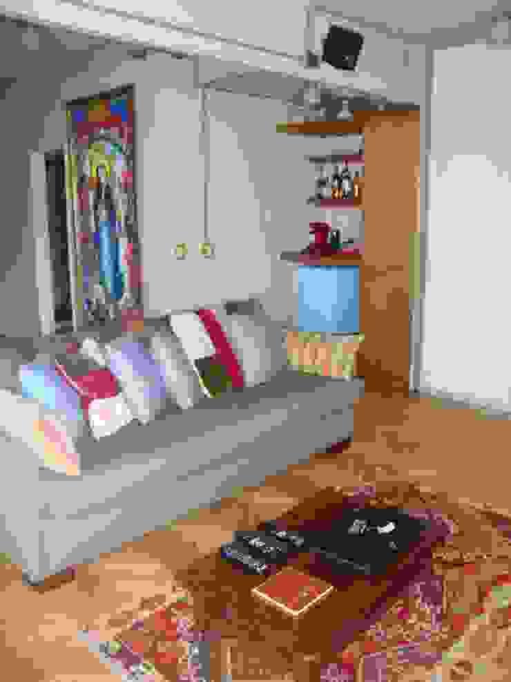 dormitorio después de intervención sector TV chill out de Hargain Oneto Arquitectas