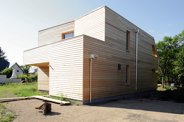 Symbios Architektur Maisons modernes Bois Marron
