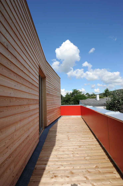 Symbios Architektur Maisons modernes Bois composite Marron