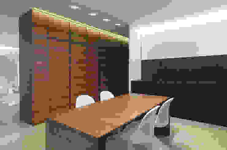 Residenza Privata - Studio Studio minimalista di Reggiani SPA Illuminazione Minimalista Legno Effetto legno