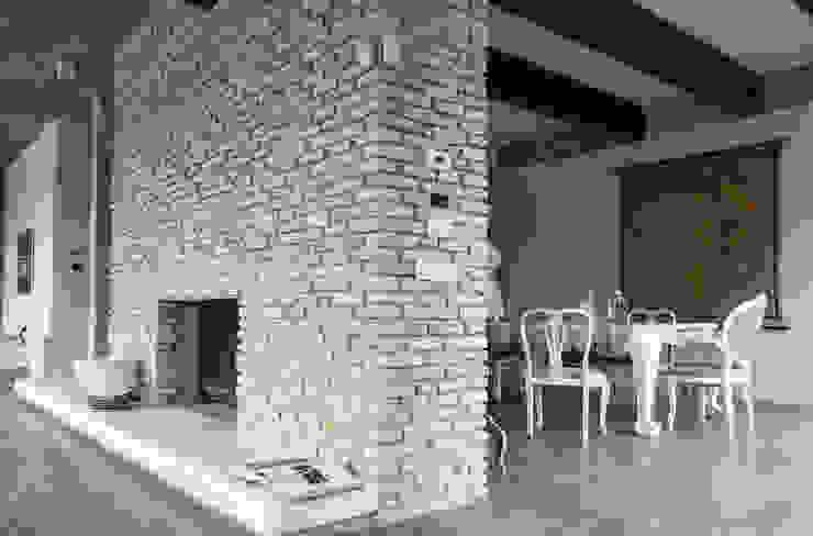 Residenza Privata - Soggiorno Soggiorno moderno di Reggiani SPA Illuminazione Moderno Pietra