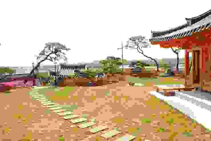 Jardines de estilo asiático de 금송건축 Asiático