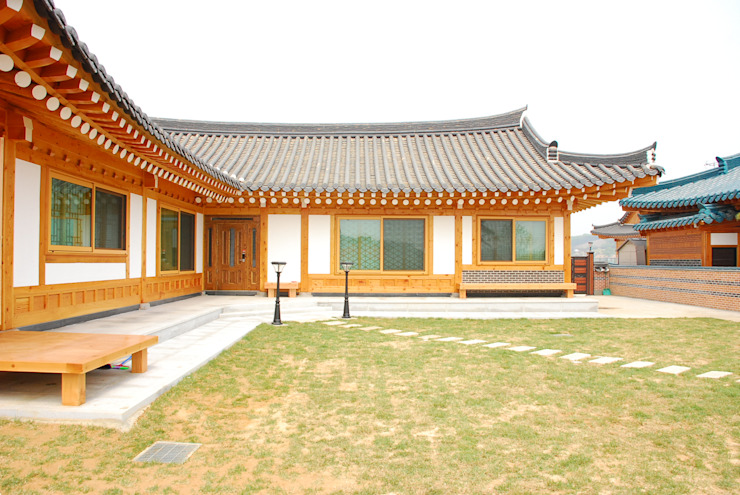 Casas de estilo asiático de 금송건축 Asiático