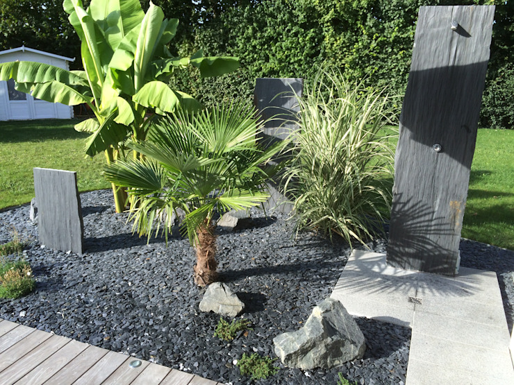 Tropical style gardens by Schwein Aménagement Tropical Stone