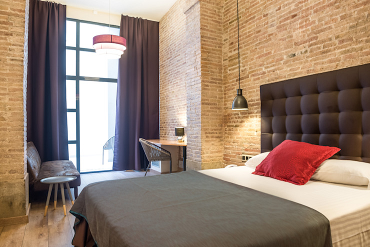 Industrial style hotels by Batua Interiores Creativos Industrial Textile Amber/Gold