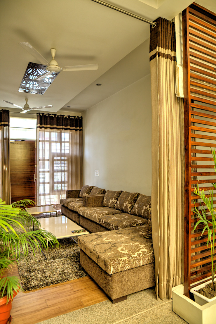 Living room Modern houses by Studio An-V-Thot Architects Pvt. Ltd. Modern