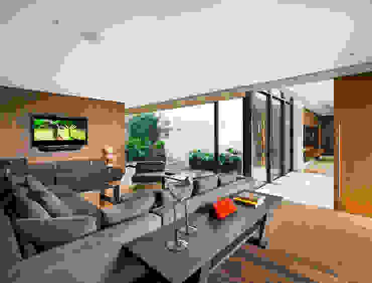 Cuarto de TV Salas multimedia modernas de C Cúbica Arquitectos Moderno