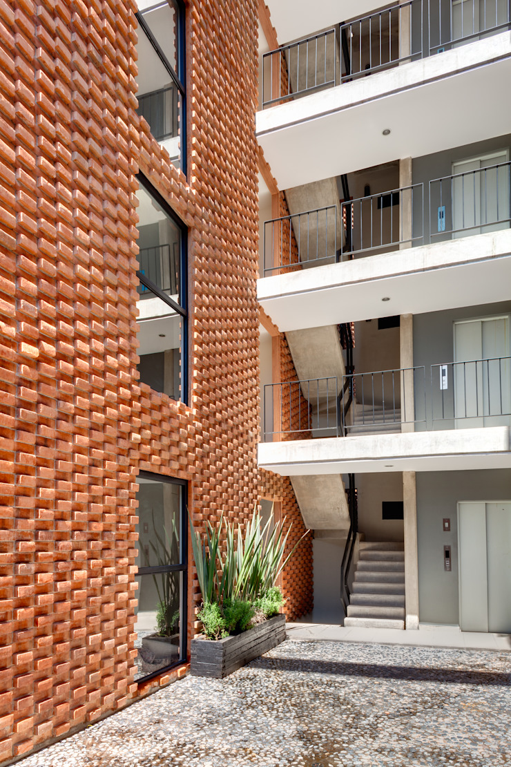 Residencial Z53 Pasillos, vestíbulos y escaleras rurales de Grupo Nodus Arquitectos Rural