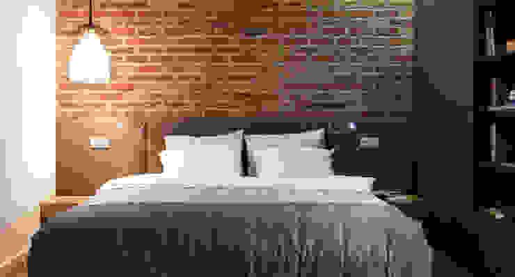 Однушка Спальня в скандинавском стиле от Lugerin Architects Скандинавский Кирпичи
