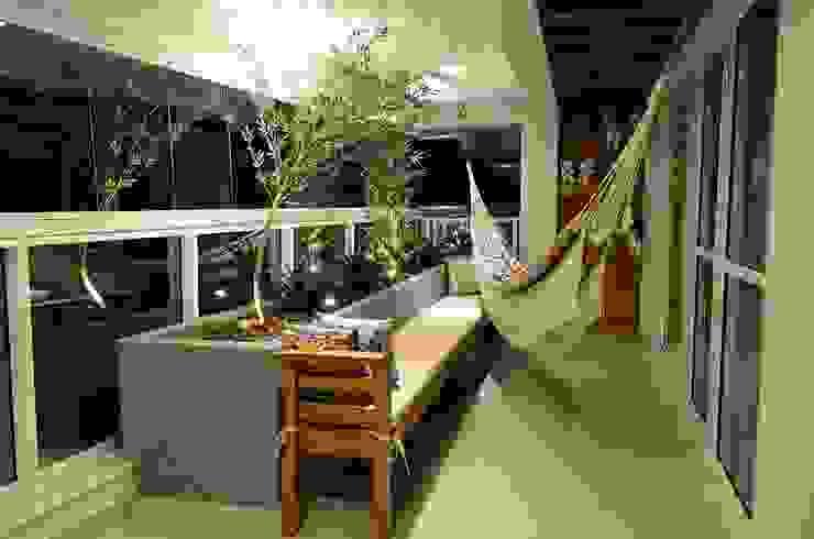 Apartamento Águas Claras Varandas, alpendres e terraços modernos por Giovana Martins Arquitetura & Interiores Moderno