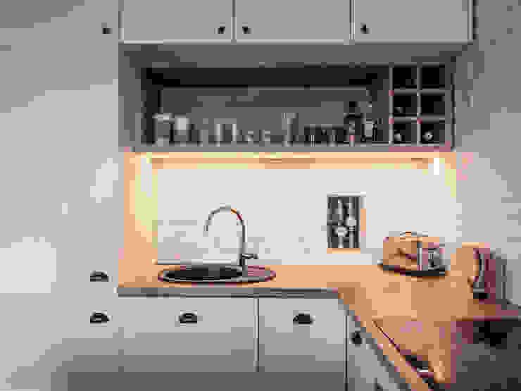 Jasno & eklektycznie Eklektyczna kuchnia od Zolnik Pracownia Eklektyczny Cegły