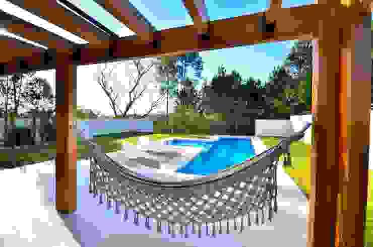 Descanso na rede Balcone, Veranda & Terrazza in stile moderno di ARQ Ana Lore Burliga Miranda Moderno