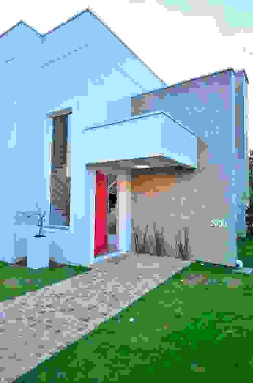 Revestimento de piso Pasinato Casas modernas de ARQ Ana Lore Burliga Miranda Moderno