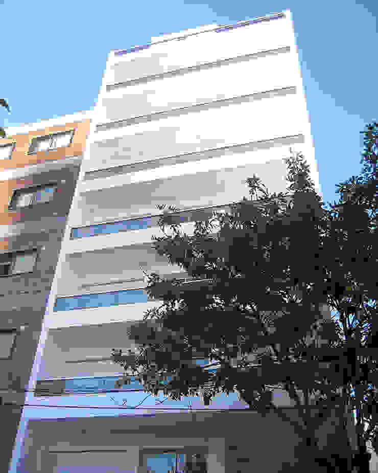 Edificio Mastil PISOS DE VIVIENDA - MONTAÑESES 2741 C.A.B.A. Casas modernas: Ideas, imágenes y decoración de RGA ARQUITECTURA Moderno Piedra