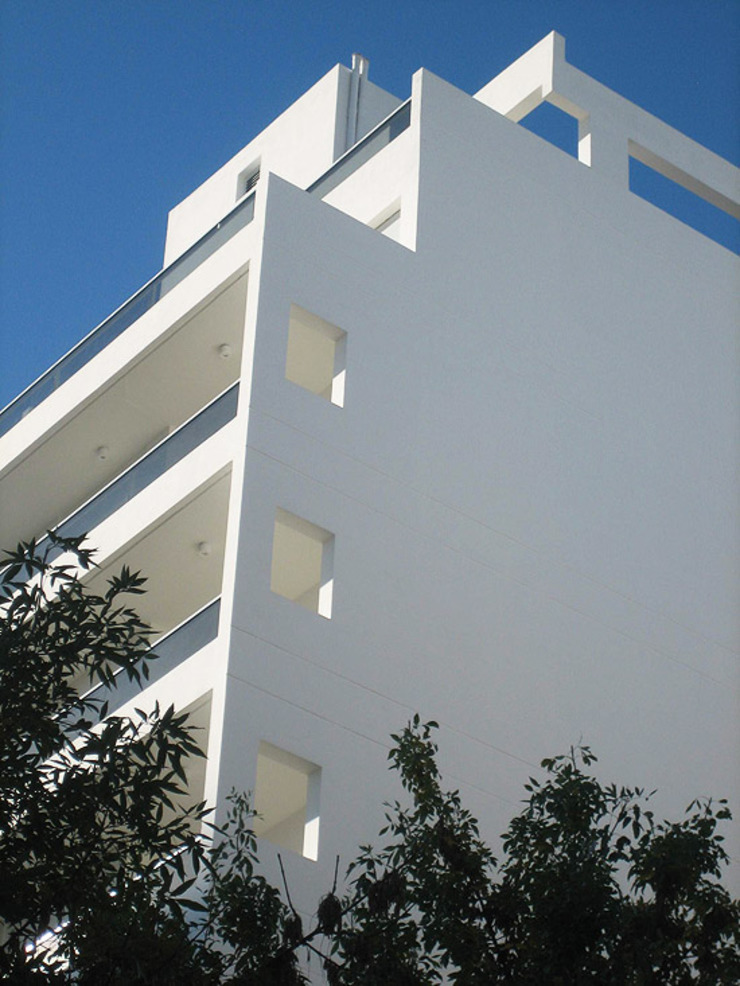Edificio Mastil PISOS DE VIVIENDA – MONTAÑESES 2741 C.A.B.A. Casas modernas: Ideas, imágenes y decoración de RGA ARQUITECTURA Moderno Piedra