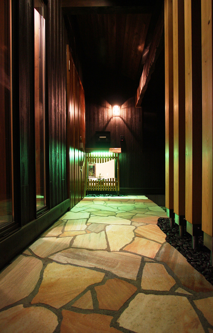 Asian style corridor, hallway & stairs by 株式会社アートカフェ Asian Stone