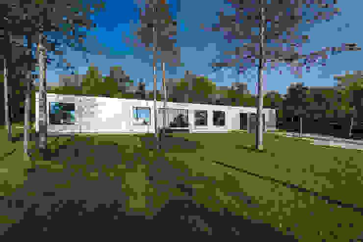 Hanglage Moderne Häuser von PLANET architects Modern