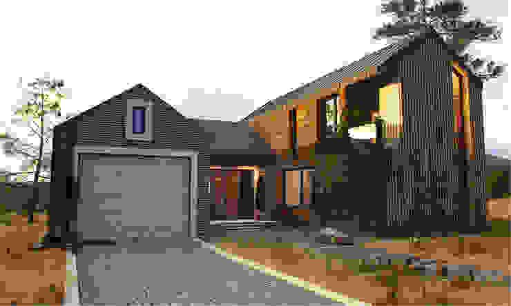 ЧАСТНЫЙ ДОМ DWELL HOUSE Дома в стиле минимализм от IK-architects Минимализм Кирпичи