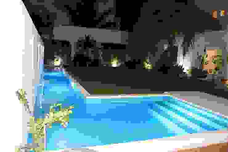 Casa habitacion en en Cozumel Quintana Roo: Albercas de estilo  por A2 HOMES SA DE CV, Minimalista