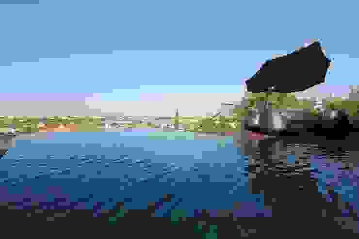 Modern pool by Riscos & Atitudes, Lda Modern Slate