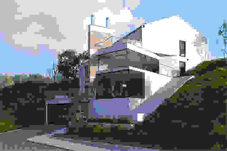 Dom jednorodzinny / Epalinges, Szwajcaria: styl , w kategorii Domy zaprojektowany przez Absens architekci,Nowoczesny