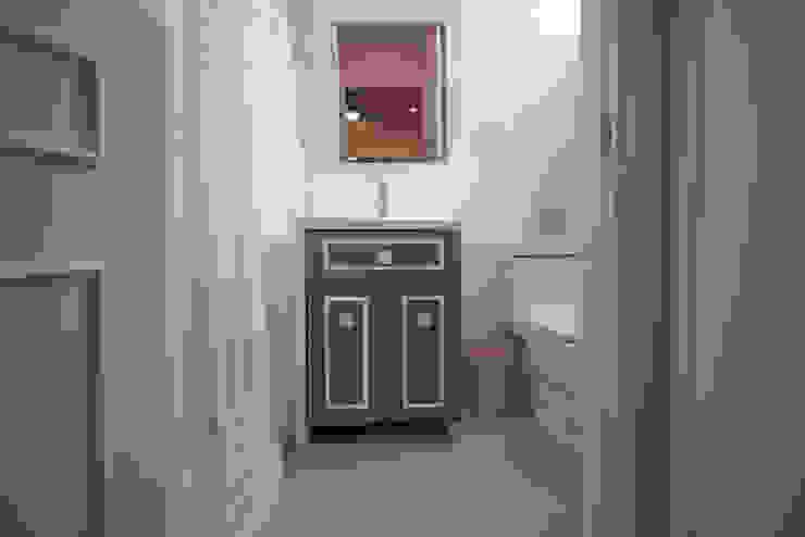 Baño recámara bebé : Baños de estilo  por ESTUDIO TANGUMA, Moderno