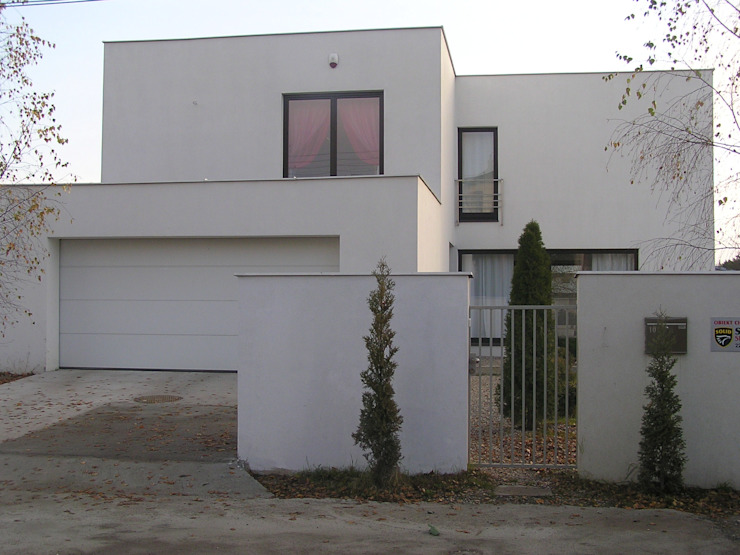 Дома в стиле модерн от ŁUKASZ ŁADZIŃSKI ARCHITEKT Модерн