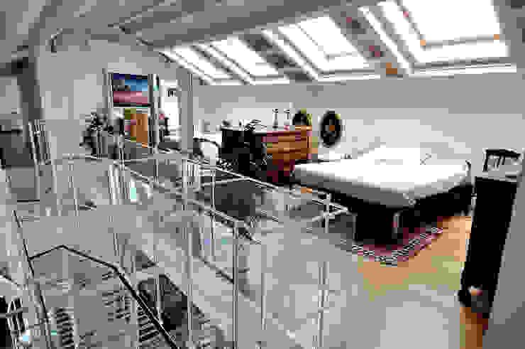 Recupero di sottotetto VITTORIO GARATTI ARCHITETTO Camera da letto moderna
