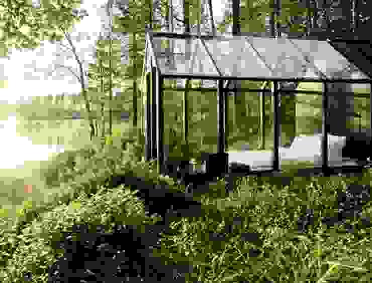 Wiejskie domy od Paul Marie Creation Garden Design & Swimmingpools Wiejski