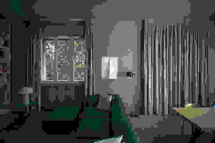 house#01 Soggiorno moderno di andrea rubini architetto Moderno Tessuti Ambra/Oro