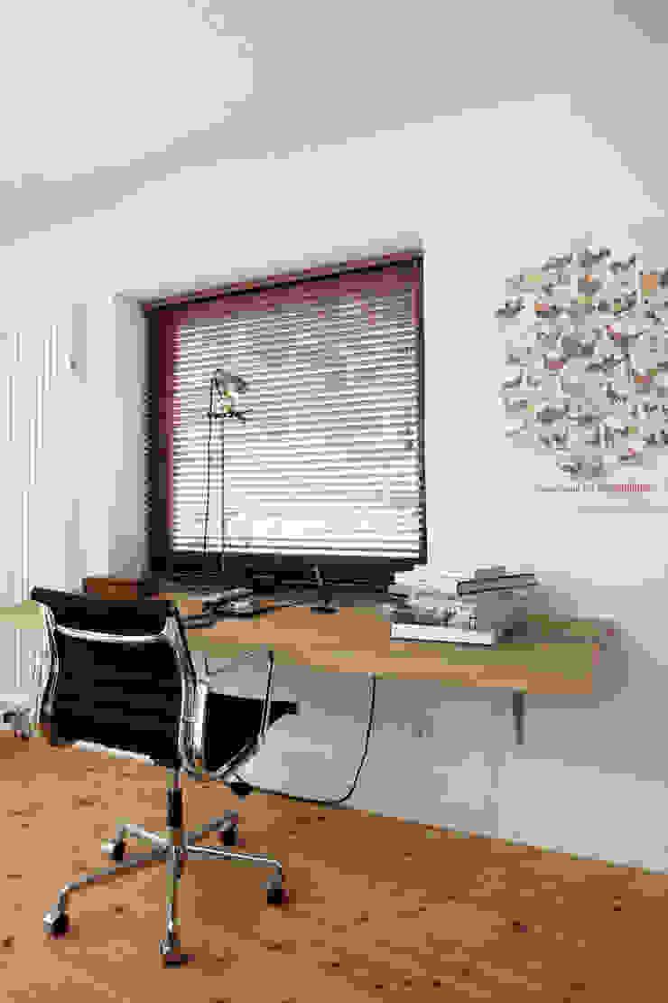 Oficinas y bibliotecas de estilo industrial de Wirth Architekten Industrial