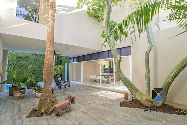 Proyecto Residencial <q>La Ramona.</q> Jardines eclécticos de PORTO Arquitectura + Diseño de Interiores Ecléctico