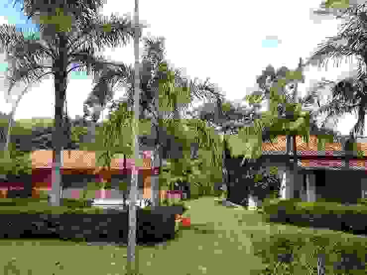 Casas de estilo  por Mina Arquitetura & Construções