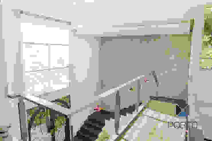 Eclectic corridor, hallway & stairs by PORTO Arquitectura + Diseño de Interiores Eclectic
