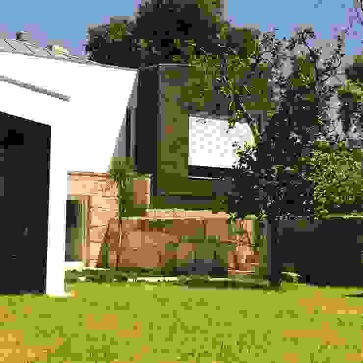 Bárbara abreu Arquitetos Casas modernas Marrón