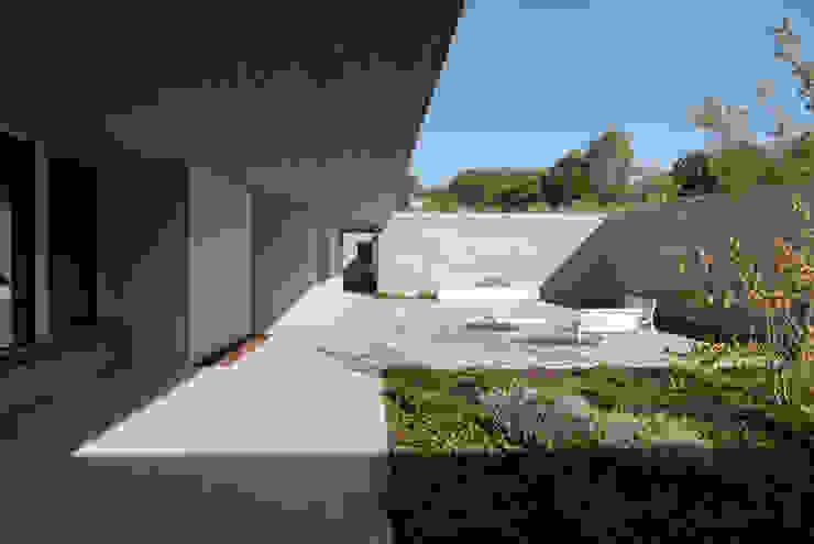Jardins mediterrâneos por Osa Architettura e Paesaggio Mediterrâneo