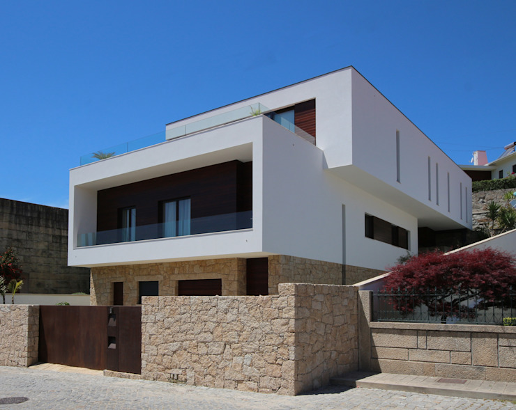Casas de estilo minimalista de 3H _ Hugo Igrejas Arquitectos, Lda Minimalista Granito