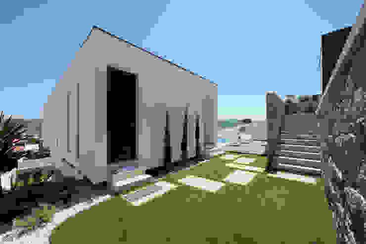 Casas de estilo minimalista de 3H _ Hugo Igrejas Arquitectos, Lda Minimalista