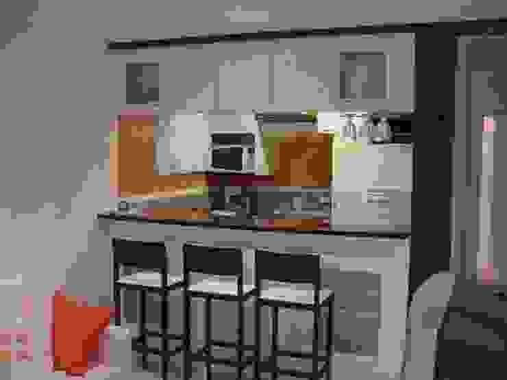 Praia de Geribá em Búzios and Apartamento Sernambetiba Cozinhas modernas por Arquitetude Moderno