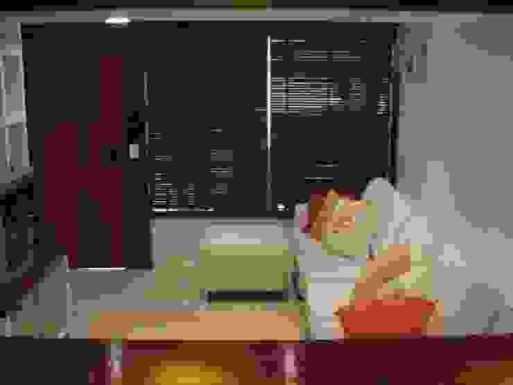 Praia de Geribá em Búzios and Apartamento Sernambetiba Salas de estar modernas por Arquitetude Moderno