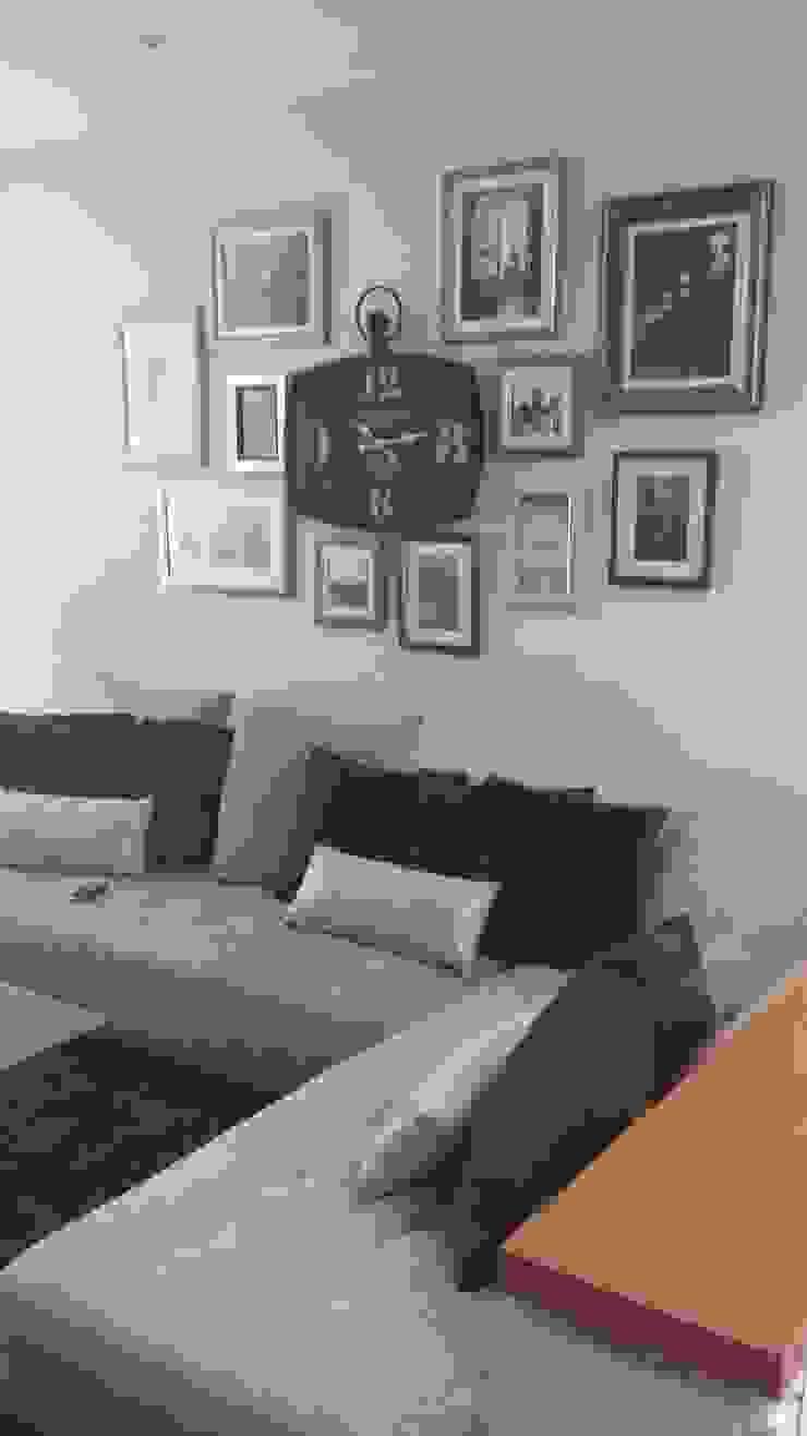 La sala, la sala de TV y la recamara del bebe Salones modernos de Paola Hernandez Studio Comfort Design Moderno