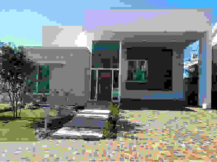 Houses by Vieitez Bernils Arquitetos Ltda., Modern