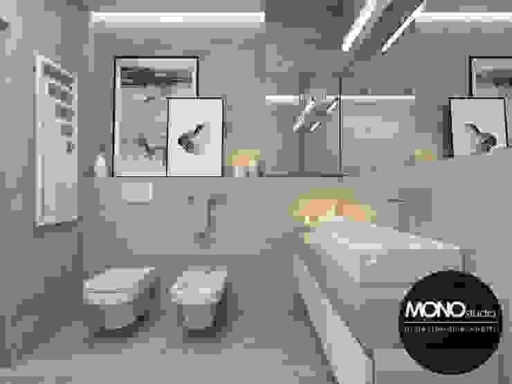 Baños modernos de MONOstudio Moderno Cerámica